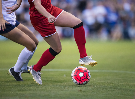 57522381 - women playing in a soccer game on a soccer field