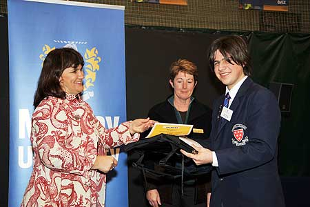 Dany Rassam accepts first prize from ASB Albany manager Norma Clark, and Massey University's Pamela von Hurst.