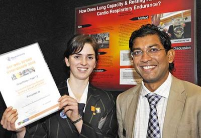 Julia Buhs-Catterall, from KingsWay School  in Orewa, who won a $3000 Massey bursary and ASB-sponsored prize for her study on how lung capacity and resting heart rate affect aerobic endurance, is pictured with senior lecturer Dr Ajmol Ali from the Institute of Food, Nutrition and Human Health.