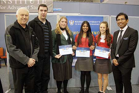 Sponsors Dairy NZ's Bill Barwood and Bennetts bookstore manager Chris Sharpe with Year 13 winners Amy van de Weg (Manurewa High School), Simone Bhagaloo and Abbie Wakelin ( Albany Senior High School), with Massey University School of Sport and Exercise senior lecturer Dr Ajmol Ali.
